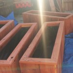 Beveled top raised bed redwood herb planters