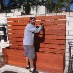 redwood privacy panel planters before install, finishing touches