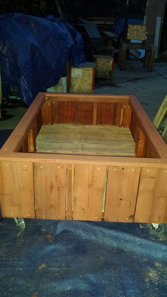 raised bed redwood planter on caster wheels