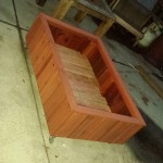 raised bed redwood planter on caster wheels